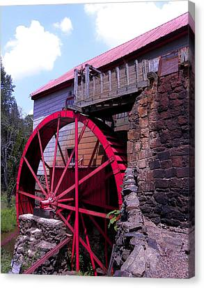 Big Red Wheel Canvas Print by Sandi OReilly
