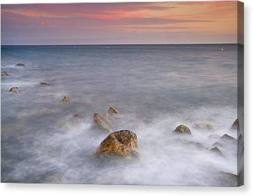 Big Rock Against The Waves Canvas Print by Guido Montanes Castillo