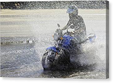 Biker  Making A Splash Canvas Print by Kantilal Patel