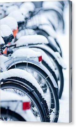 Canvas Print featuring the photograph Bikes In Snow by Andrew  Michael