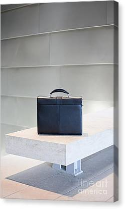 Black Briefcase On White Stone Bench Canvas Print