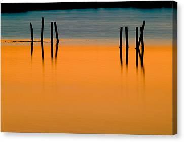 Black Pilings Orange Water Canvas Print by Rich Franco