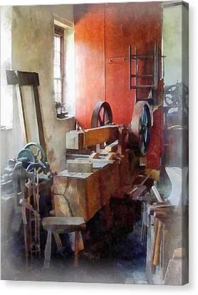 Blacksmith Shop Near Windows Canvas Print by Susan Savad