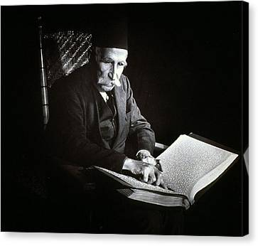 Blind Man Reading A Braille Book, Ca Canvas Print by Everett