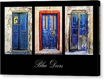 Blue Doors Of Santorini Canvas Print by Meirion Matthias