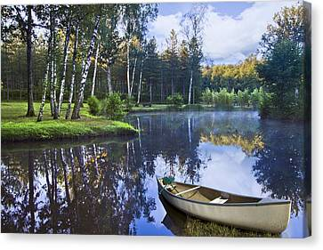 Blue Lake Canvas Print by Debra and Dave Vanderlaan