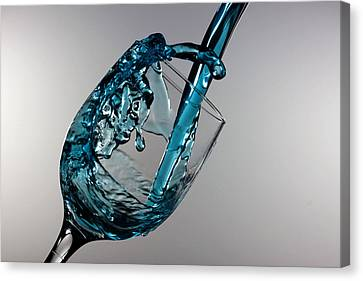 Blue Martini Splashing From A Wine Glass Canvas Print by Paul Ge