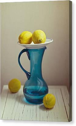 Old Pitcher Canvas Print - Blue Pitcher With Lemons On White Plate by Copyright Anna Nemoy(Xaomena)