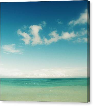Blue Sky Over Ocean Canvas Print by Jodie Griggs