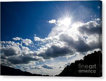 Blue Sky With Clouds Canvas Print by Mats Silvan