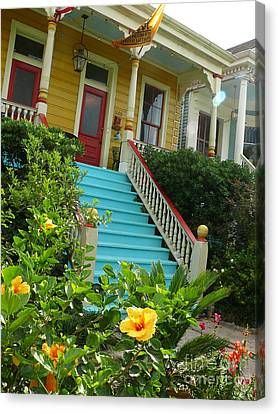 Canvas Print featuring the photograph Blue Stairs Yellow House by Jeanne  Woods