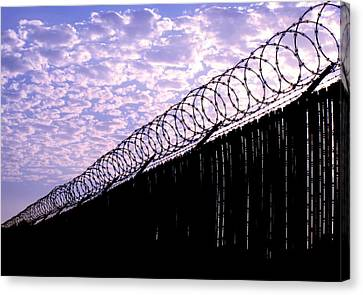 Blue Sunset And Barbed Wire Canvas Print