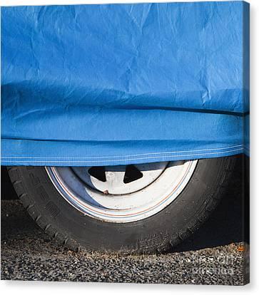 Blue Tarp And Car Wheel Canvas Print by Paul Edmondson