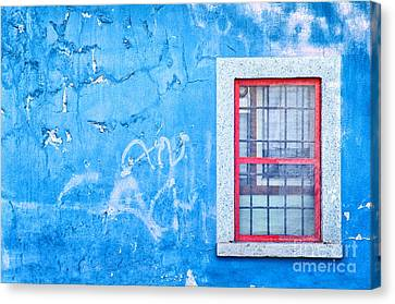 Blue Wall And Window With Red Frame Canvas Print by Silvia Ganora