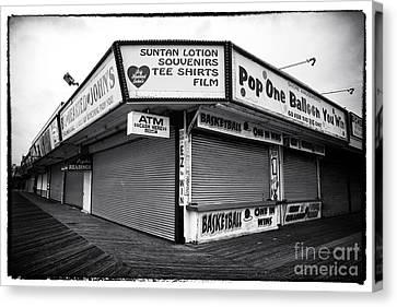 Boardwalk Shopping Canvas Print by John Rizzuto