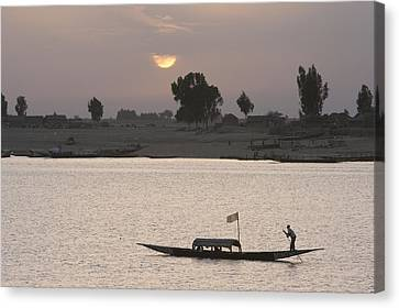 Boat On The Niger River In Mopti, Mali Canvas Print by Peter Langer