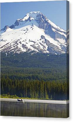 Boating In Trillium Lake With Mount Canvas Print by Craig Tuttle