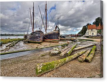 Boats And Logs At Pin Mill Canvas Print by Gary Eason