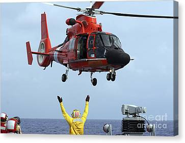 Law Enforcement Canvas Print - Boatswain Mate Directs A Hh-65a Dolphin by Stocktrek Images
