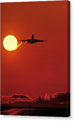 Boeing 747 Taking Off At Sunset Canvas Print by David Nunuk
