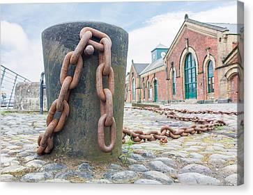 Bollard And Chain Canvas Print by Semmick Photo