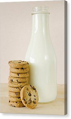 Bottle Of Milk And Chocolate Chip Cookies, Studio Shot Canvas Print by Tetra Images