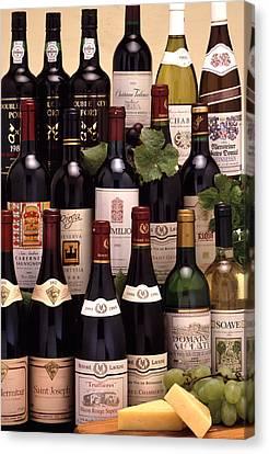 Bottles Of Wine Canvas Print by Victor De Schwanberg
