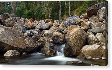 Boulders On The River Canvas Print by Mark Lucey
