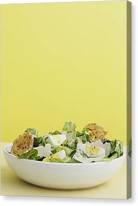 Bowl Of Caesar Salad With Egg Canvas Print by Cultura/BRETT STEVENS