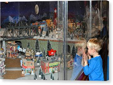 Canvas Print featuring the photograph Boy And Christmas Trains by Diane Lent