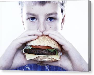 Boy Eating A Burger Canvas Print by Kevin Curtis