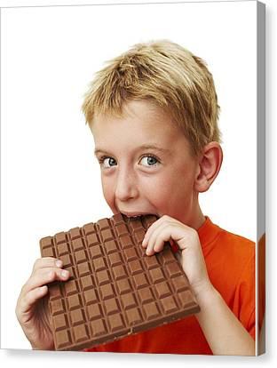 Boy Eating Chocolate Canvas Print by Ian Boddy