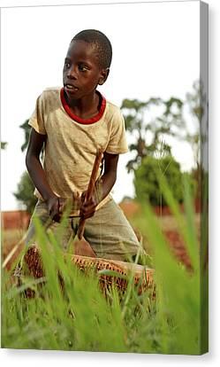Boy Playing A Drum, Uganda Canvas Print by Mauro Fermariello