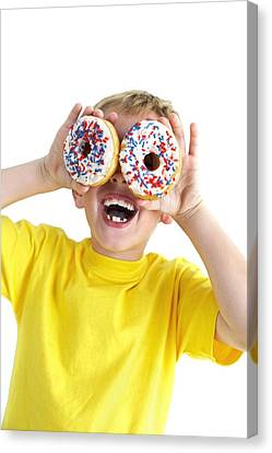 Boy Playing With Doughnuts Canvas Print by Ian Boddy