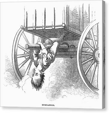 Boy Riding Under Wagon Canvas Print by Granger