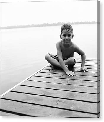 Boy Sitting On Dock Canvas Print by Michelle Quance