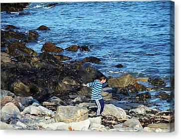 Canvas Print featuring the photograph Boy Throwing A Stone Maine Coast by Maureen E Ritter