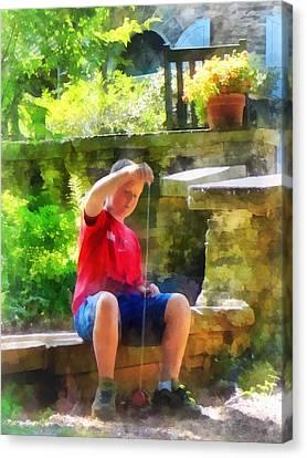 Boy With Yoyo Canvas Print by Susan Savad