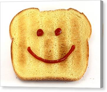 Bread With Happy Face Canvas Print by Blink Images