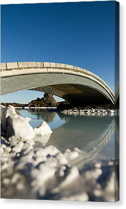 Bridge Over The Blue Lagoon Canvas Print by Andres Leon
