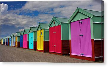 Brighton Beach Huts Canvas Print by Phil Clements