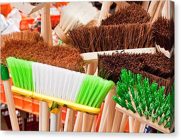 Brooms Canvas Print by Tom Gowanlock
