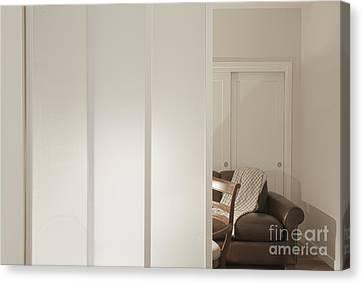 Brown Leather Sofa Seen Through Open Door Canvas Print by Andersen Ross