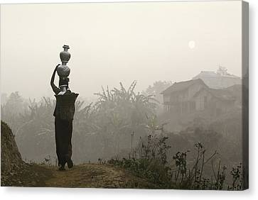 Bru Tribeswoman Carrying Water Pots On Canvas Print by Axiom Photographic