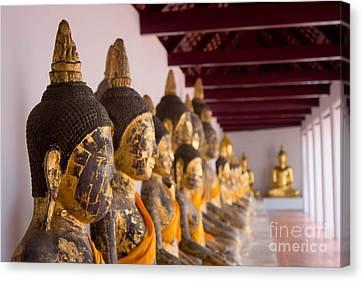 Buddha Culptures Canvas Print by Asaha Ruangpanupan