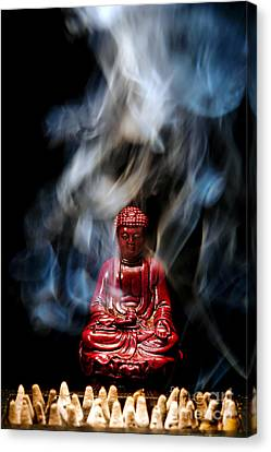 Buddha In Smoke Canvas Print by Olivier Le Queinec