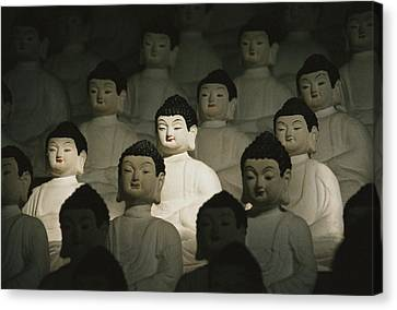 Buddha Statues In The Cave Temple Canvas Print by Martin Gray