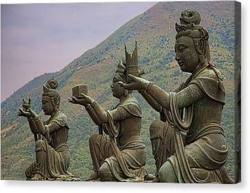 Buddhistic Statues Canvas Print by Karen Walzer