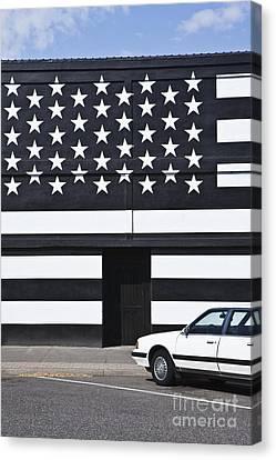 Building With An American Flag Paint Job Canvas Print by Paul Edmondson
