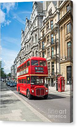 Bus On Piccadilly Canvas Print by Andrew  Michael